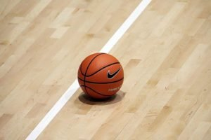 basketball in the floor of a basketball court
