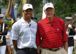Tiger Woods standing with a friend